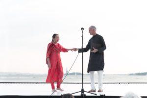 Jonathan Hollander introduces Janaki Patrik, Robert Wagner Park, overlooking Statue of Liberty.